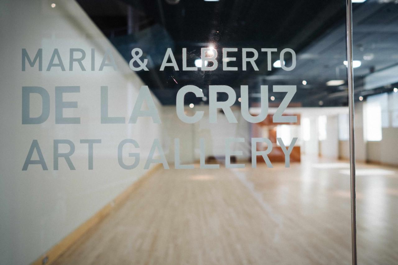 de la Cruz Gallery interior window with logo