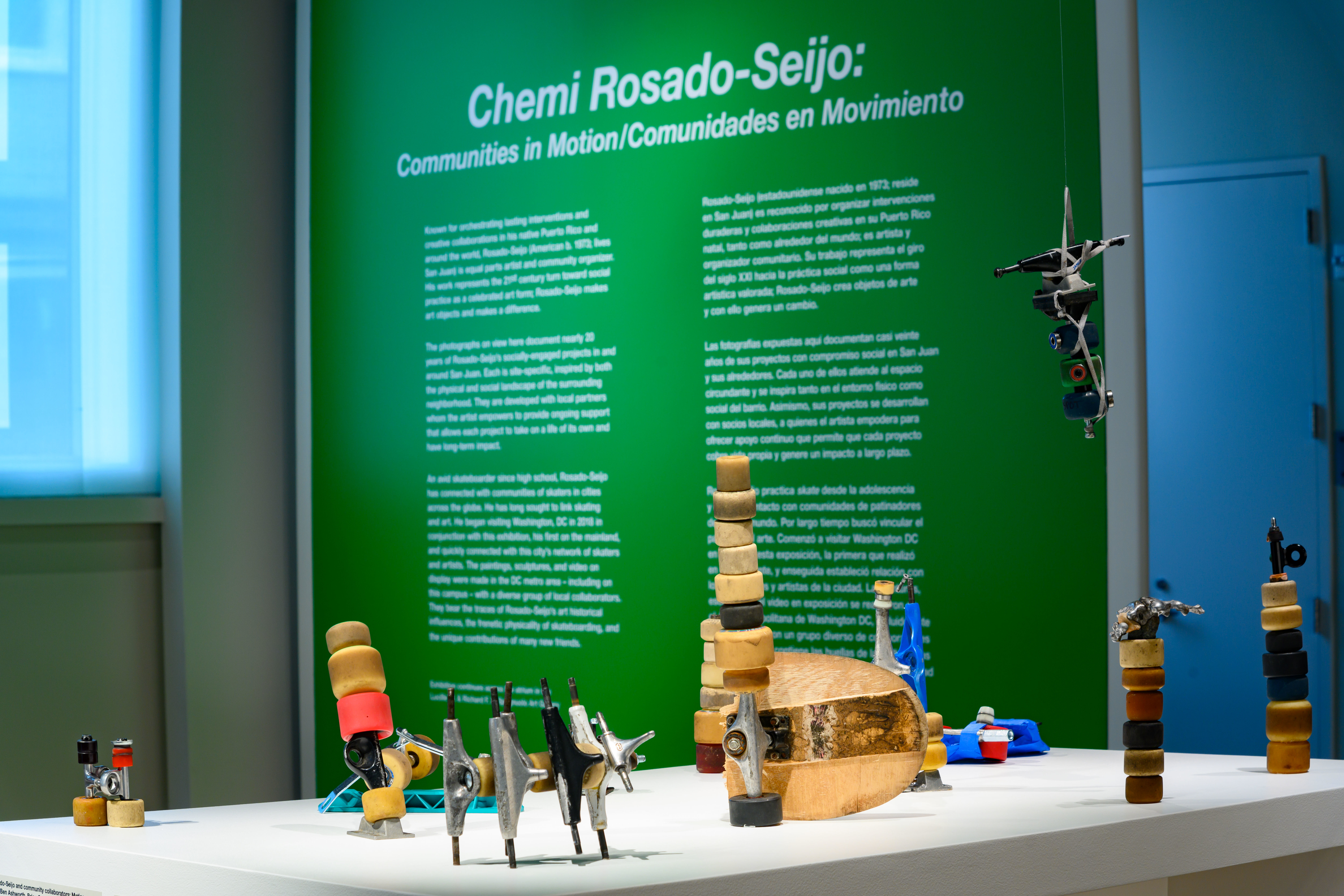Chemi Rosado-Seijo and student collaborative sculptures with vinyl exhibition text in the background